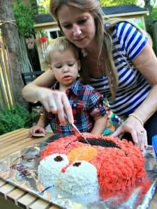 cutting the elmo cake